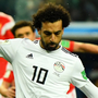 Spot on: Egypt's Mohamed Salah scores from the penalty spot to reduce the arrears in last night's Group A defeat to Russia