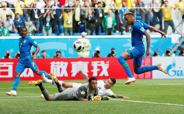 TWO'S COMPANY: Neymar adds Brazil's second goal in the win over Costa Rica in St Petersburg yesterday.