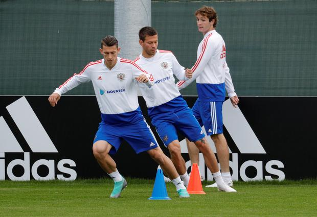 MISSION: (l-r) Russia's Ilya Kutepov, Fyodor Smolov and Mario Fernandes are pictured during training ahead of Saturday's World Cup quarter-final clash with Croatia. Photo: REUTERS