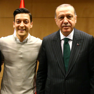 Turkish President Tayyip Erdogan with Mesut Ozil. Photo: Reuters