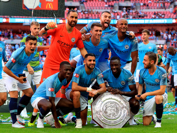 SHIELD WIN: Manchester City players celebrate with the Community Shield after beating Chelsea yesterday. Photo: PA