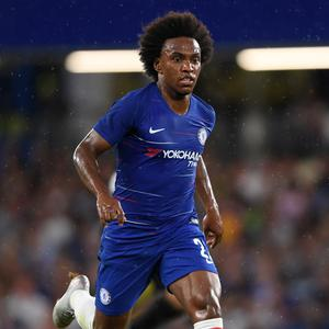 Willian has since revealed he turned down Barcelona to remain at Chelsea and, having played 76 minutes of their opening-day victory at Huddersfield, said he is still at the club because Conte has gone. Pic: Getty Images