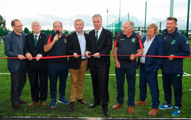 OPEN FOR PLAY: Lakewood FC astro pitch in Cork was offically opened by FAI chief executive John Delaney, centre, and from left, Ireland senior manager Martin O'Neill, FAI President Tony Fitzgerald, Brendan Lenihan (Lakewood FC), Minister for Agriculture Michael Creed TD, along with Joe Dillon (Chair on behalf of Lakewood FC), Peter De Foubert (chairman of Lakewood social club) and Ireland women's manager, Colin Bell