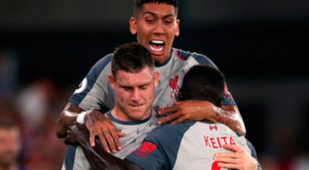 SPOT ON: Liverpool's James Milner celebrates scoring his side's first goal from the penalty spot during the Premier League win over Crystal Palace at Selhurst Park last night. Photo: PA
