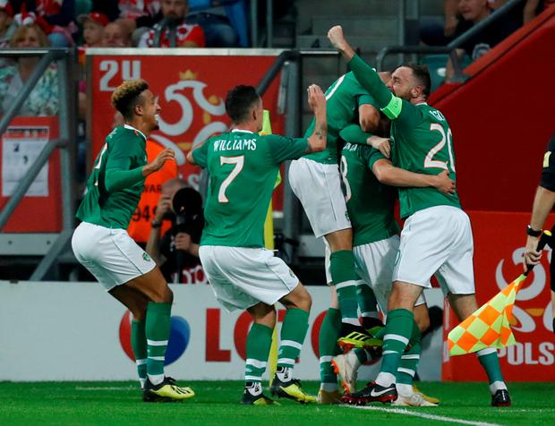 GREEN SHOOTS: Ireland players congratulate Aiden O'Brien on his goal against Poland on Tuesday. Pic: Reuters