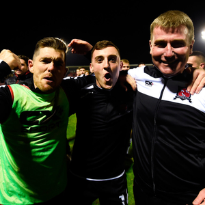 NEARLY THERE: Dundalk manager Stephen Kenny celebrates with Ronan Murray, left, and Dylan Connolly after last Friday's win over Cork City. The Lilywhites aim to all but seal the Premier Division title against Derry City tonight. Photo: Sportsfile