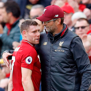 RED REIGN: Liverpool manager Jurgen Klopp embraces James Milner after being substituted with an injury during the Premier League match against Manchester City last Sunday. Photo: PA