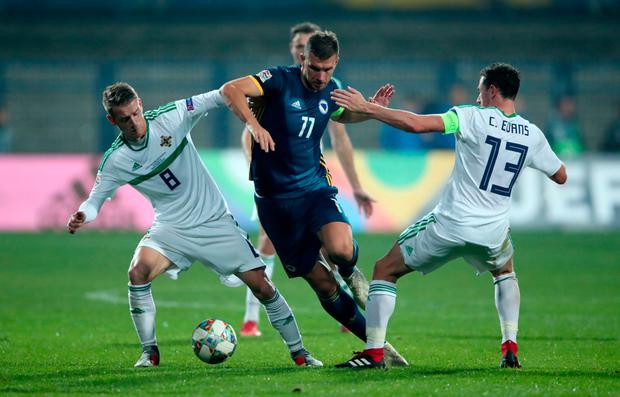 ON THE DOUBLE: Bosnia's Edin Dzeko (centre) battles for the ball with Northern Ireland's Steven Davis (left) and Corry Evans during the Nations League match in Sarajevo. Photo: PA
