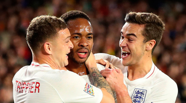 STERLING SERVICE: Raheem Sterling (c) celebrates scoring England's opener against Spain in Seville last night. Photo: PA