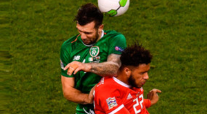 Ireland's Shane Duffy challenges Tyler Roberts of Wales during the Nations League B Group Four match at the Aviva Stadium