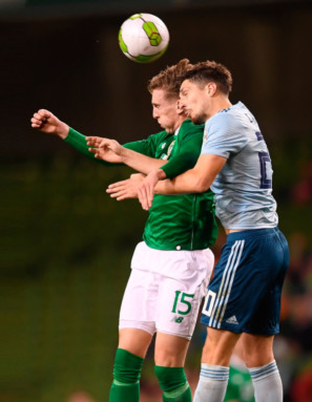 NEW BLOOD: Ireland striker Ronan Curtis is challenged by Northern Ireland's Craig Cathcart during last Thursday's friendly match at the Aviva. Pic: Sportsfile