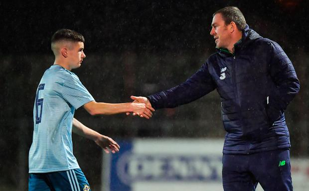 NEW ROLE: Ireland U16s coach Richard Dunne shakes hands with Orrin McLaughlin of Northern Ireland U16s. PIc: Sportsfile
