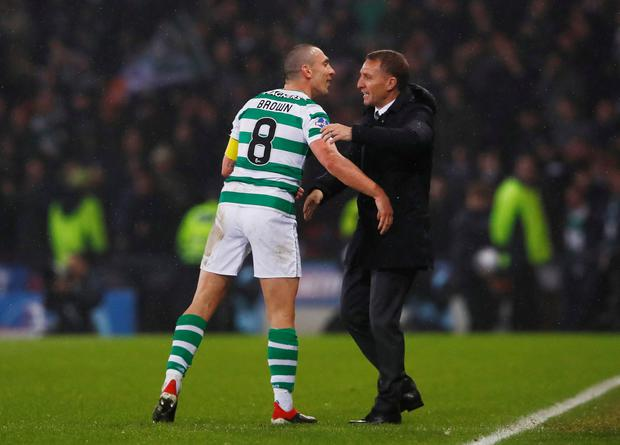 GLORY: Scott Brown and Brendan Rodgers. Photo: Action Images via Reuters