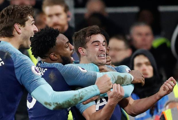SPURRED ON: Harry Winks celebrates his injury-time winner. Pic: AP