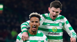 Glory Bhoys: Celtic striker Scott Sinclair celebrates scoring their second goal with team-mate Oliver Burke against St Mirren last night