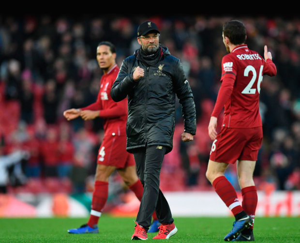 NO WOBBLE: Liverpool's manager Jurgen Klopp celebrates with defender Andrew Robertsonafter beating Bournemouth at Anfield. Pic: Getty Images