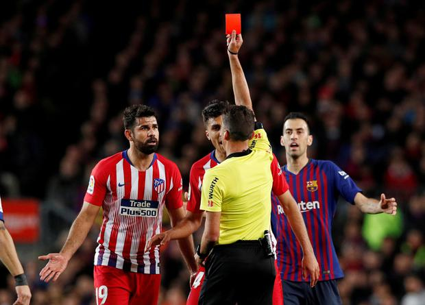 Atletico Madrid's Diego Costa is shown a red card by referee Jesus Gil Manzano. Photo: REUTERS/Albert Gea/File Photo