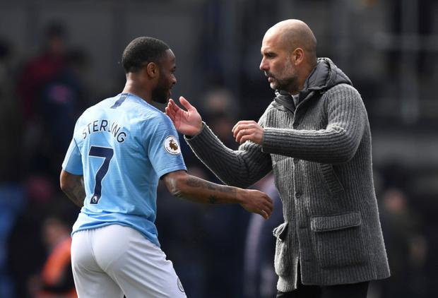 WINNER: Manchester City's Raheem Sterling celebrates after the win at Palace with manager Pep Guardiola. Photo: Action Images via Reuters