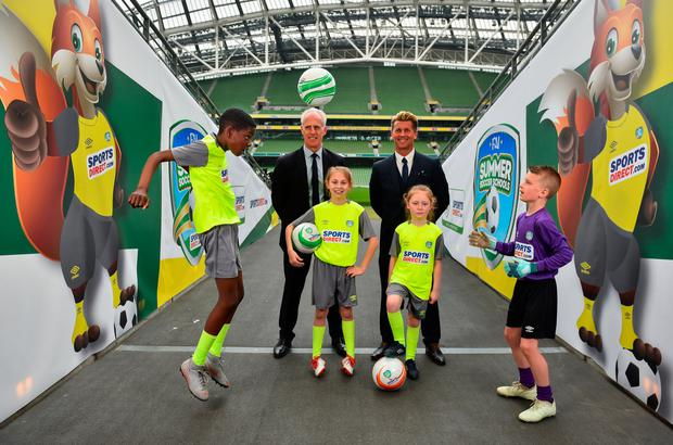 READY TO GO: Republic of Ireland mens national team manager Mick McCarthy, and Republic of Ireland Womens national team manager Colin Bell at the Aviva Stadium to launch the 2019 SportsDirect.com FAI Summer Soccer Schools programme with (l-r) Murphy Alade (11) from Irishtown, Dublin, sisters Nicole Carberry (10) and Sarah Carberry (7) from Athlone and Jamie Stafford Doyle (10) from Rosslare