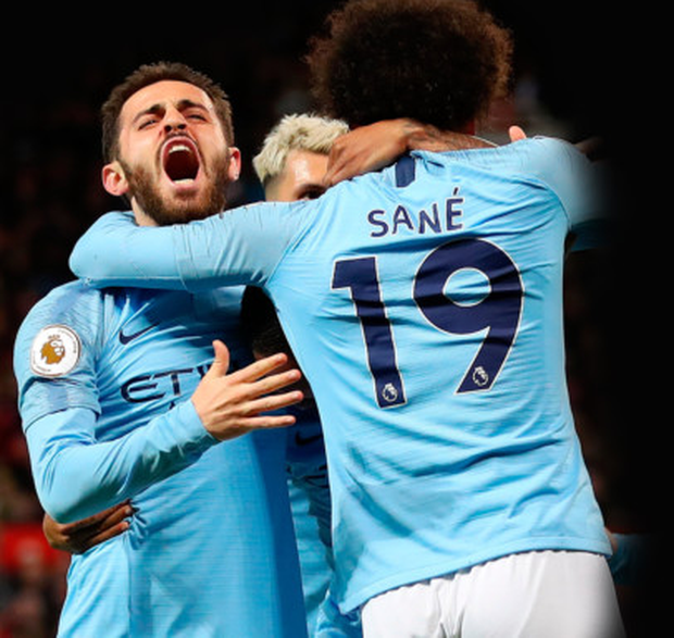 TWO BLUE: Manchester City goalscorers Bernardo Silva and Leroy Sane celebrate in last night's win over Manchester United at Old Trafford