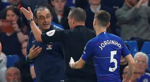 Chelsea manager Maurizio Sarri with referee Kevin Friend