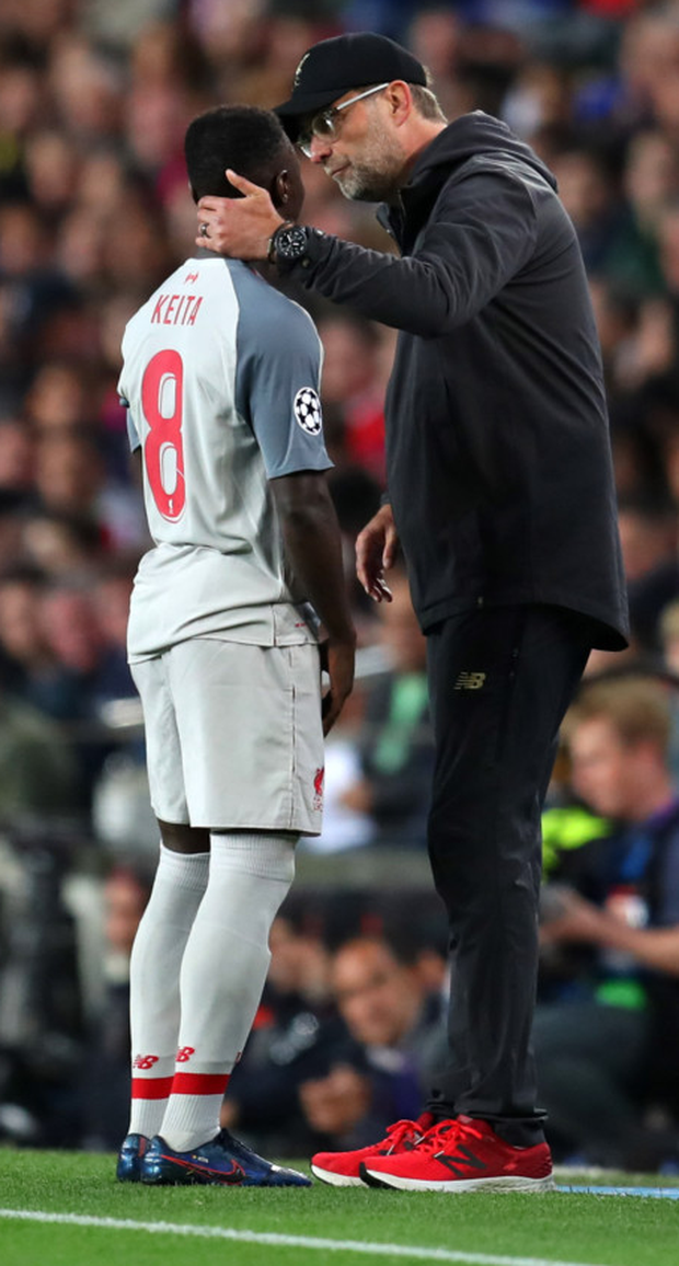 Liverpool manager Jurgen Klopp is pictured with an injured Naby Keita during the midweek Champions League defeat to Barcelona