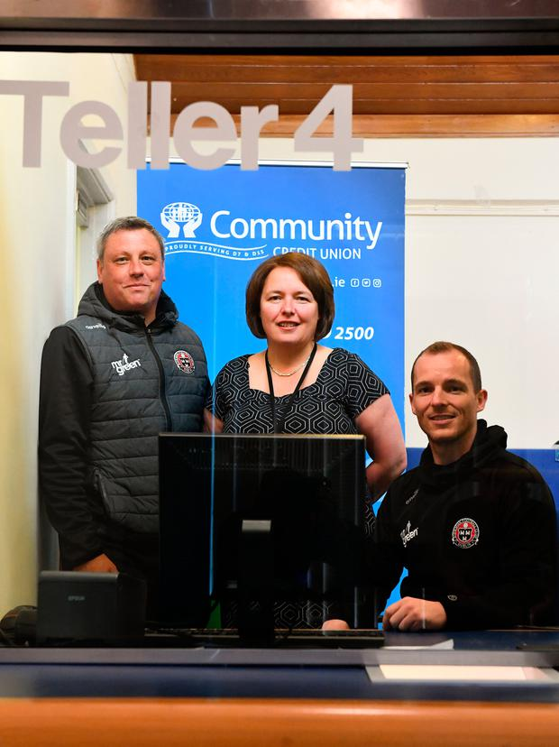 Bohemians manager Keith Long (left) and captain Derek Pender launch the new multiyear commercial partnership between Bohemians and Community Credit Union with Sue Callanan, Head of Business Development, at their Cabra West Branch