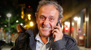 Michel Platini outside the French police anti-corruption and financial crimes office in Paris