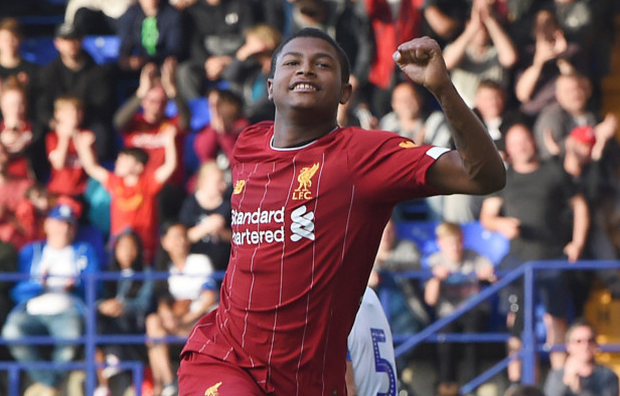Rhian Brewster celebrates one of his goals against Tranmere on Thursday. Photo: John Powell/Liverpool FC via Getty Images