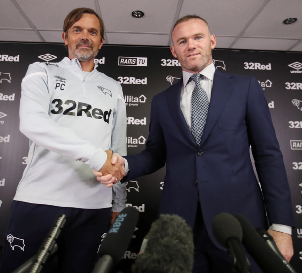 Derby boss Philip Cocu with Wayne Rooney at the announcement of the 33-year-old as a player-coach