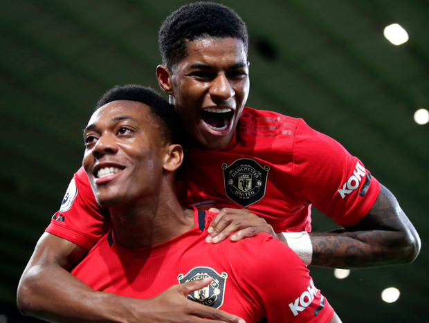 Marcus Rashford (top), here celebrating Anthony Martial's goal, has defended Paul Pogba