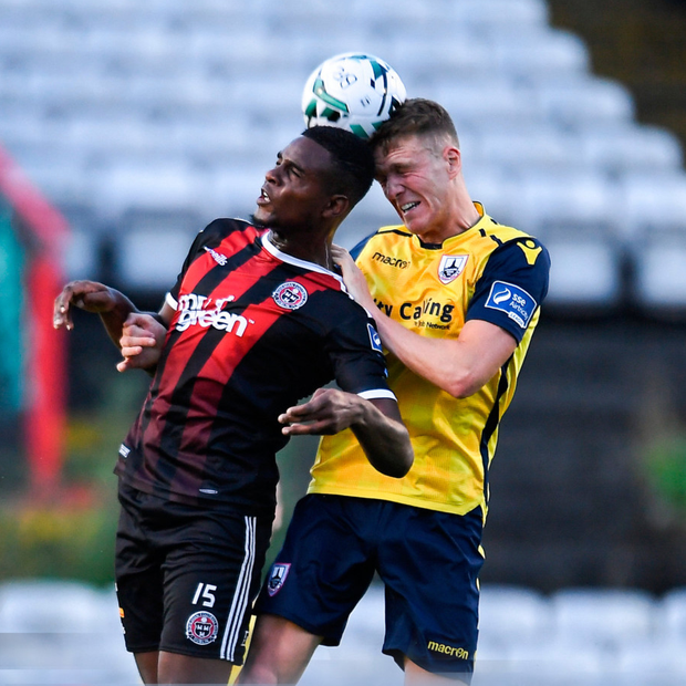 DUEL: Bohs' Andre Wright and Longford Town's Michael McDonnell compete for the ball at Dalymount Park Pic: Sportsfile
