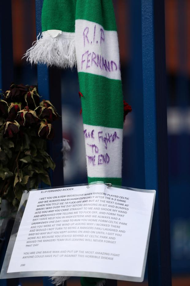 A Celtic scarf and tribute to former Rangers player Fernando Ricksen
