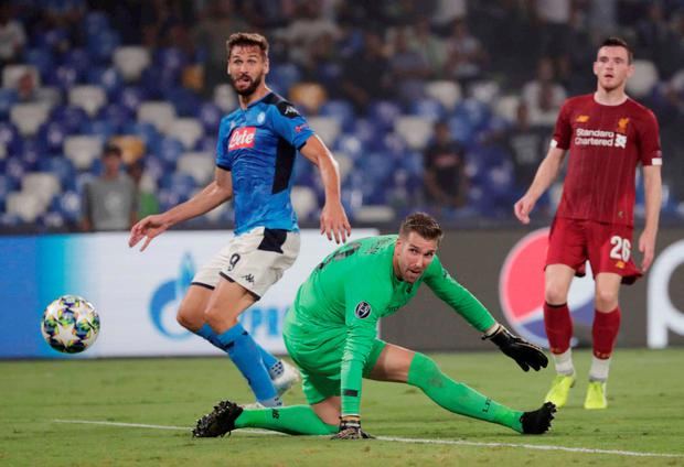 Napoli's Fernando Llorente scores their second goal as Liverpool's Adrian and Andrew Robertson look on
