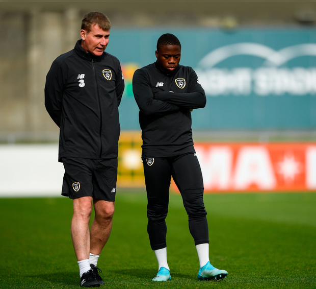 Stephen Kenny speaks with Michael Obafemi at Tallaght Stadium