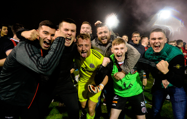 EURO GOAL: Bohemians players Danny Mandroiu (l) James Talbot (c) and Ross Tierney (r) celebrate with fans at Richmond Park on Friday. Photo: SPORTSFILE