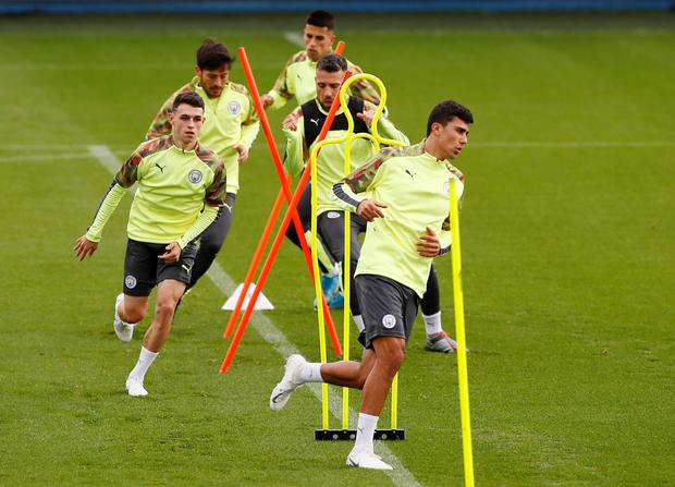 THROUGH THEIR PACES: Manchester City's Rodri and Phil Foden during training. Pic: Reuters