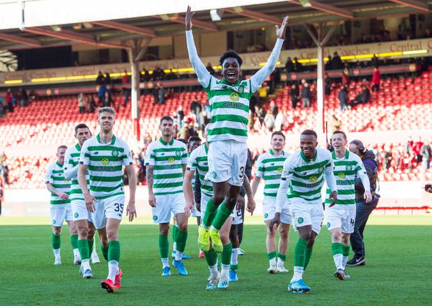 Jeremie Frimpong celebrates with his team mates in front of the Celtic fans after the Ladbrokes Scottish Premiership match at Pittodrie Stadium, Aberdeen. PA Photo