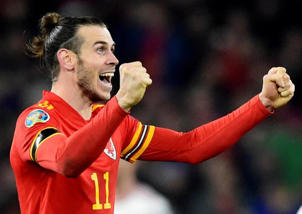Gareth Bale has club woes at the moment, getting in hot water back in Madrid for holding the above flag after Wales's win over Hungary, but he has made it to the Euros