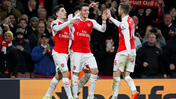Arsenal's Mesut Ozil celebrates scoring their second goal with Hector Bellerin and Aaron Ramsey