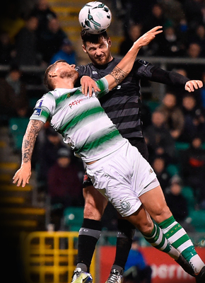 Dundalk's Pat Hoban gets to the ball ahead of Rovers' Lee Grace in last night's clash at Tallaght Stadium