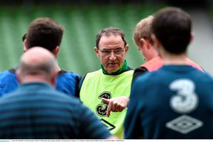 Martin O'Neill speaks to the players in training