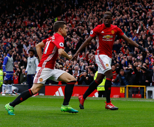 Ander Herrera (l) celebrates his goal for Manchester United in the win over Chelsea yesterday with team-mate Paul Pogba. Photo: