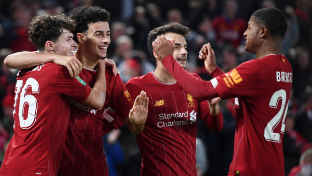 Neco Williams of Liverpool is congratulated by Curtis Jones and Rhian Brewster after assisting Liverpool's fifth goal of the game during the League Cup match between Liverpool and Arsenal