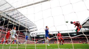 OPENER: Sadio Mane heads home the opening goal for Liverpool yesterday. Photo: PA