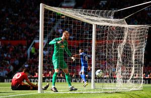 MESS: United keeper David de Gea reacts to Nathaniel Mendez-Laing's second goal for Cardiff yesterday. Pic: Getty