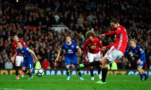 Zlatan Ibrahimovic scores from the penalty spot