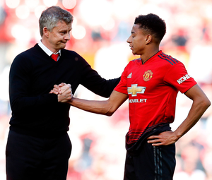 Manchester United manager Ole Gunnar Solskjaer is pictured with Jesse Lingard after Sunday's defeat to Cardiff