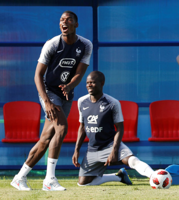 WORLD OF FUN: France's Paul Pogba and N'Golo Kante are pictured during squad training in Glebovets, Russia