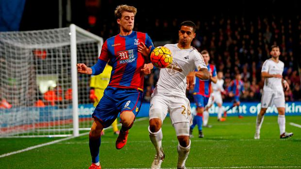 Patrick Bamford of Crystal Palace competes for the ball with Kyle Naughton of Swansea City